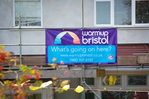 Warm Up Bristol banner on house having external solid wall insulation