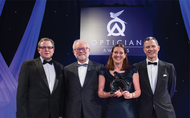 Miles Jupp (Host), Peter Warren (Chairman, AIO) and Chris Bennett (Editor and Publisher, Optician magazine) with Lynne Fernandes